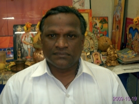 Astrologer Sai Bharathi at his workplace.