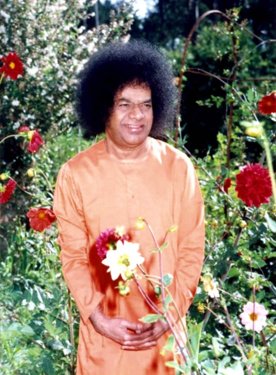 Sathya Sai Baba with flowers